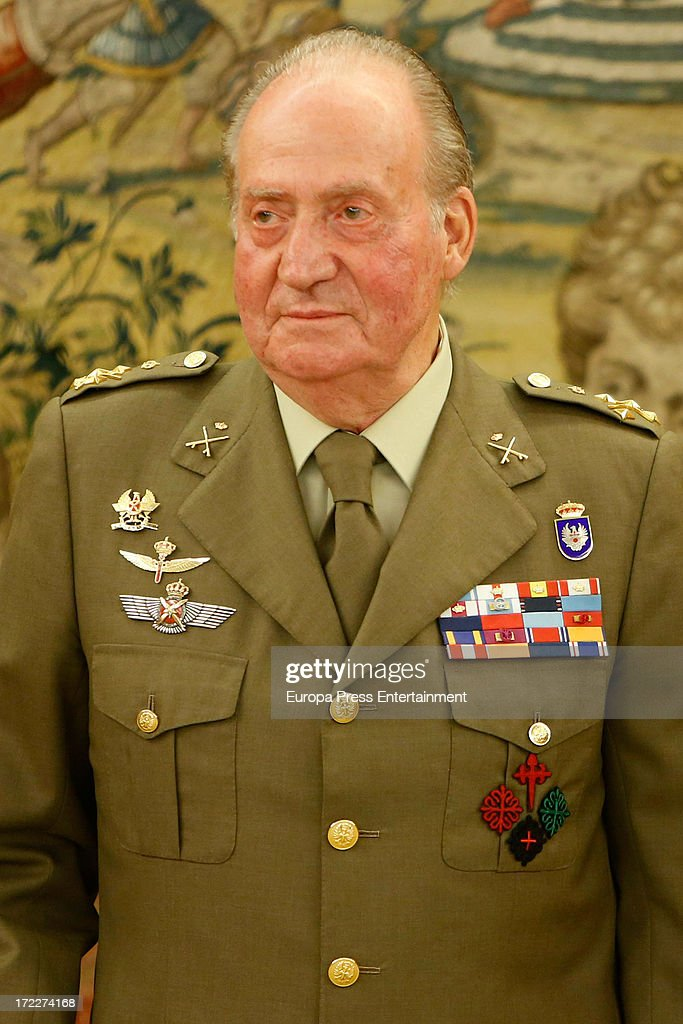 King Juan Carlos of Spain attends several military audiences at Zarzuela Palace on July 2, 2013 in Madrid, Spain. For the first time in months, the King is seen walking with only one crutch.