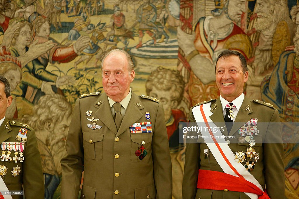 King Juan Carlos of Spain C) attends several military audiences at Zarzuela Palace on July 2, 2013 in Madrid, Spain. For the first time in months, the King is seen walking with only one crutch.