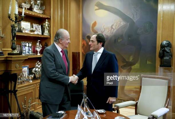 King Juan Carlos of Spain greets Foreign Minister of Portugal Paulo Portas at the Zarzuela Palace on February 26 2013 in Madrid Spain