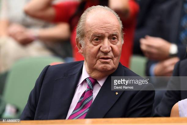 King Juan Carlos of Spain looks on from the centre court royal box prior to the Ladies Singles final between Venus Williams of The United States and...