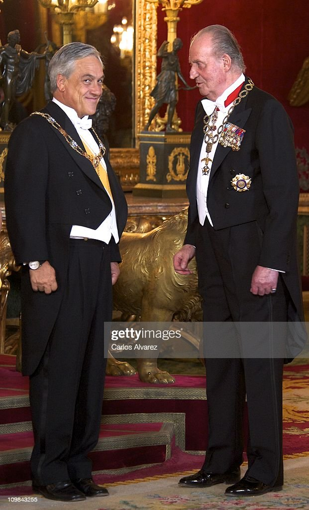 King Juan Carlos of Spain (R) receives Chilean President Sebastian Pinera (L) for a Gala Dinner at the Royal Palace on March 7, 2011 in Madrid, Spain.