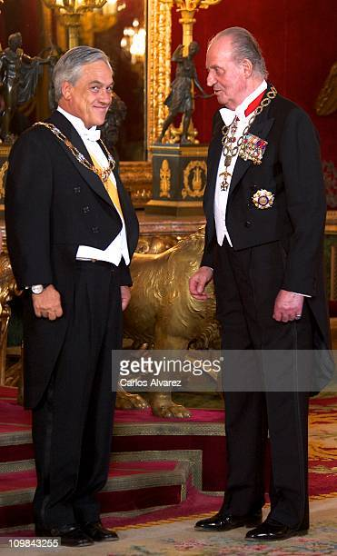 King Juan Carlos of Spain receives Chilean President Sebastian Pinera for a Gala Dinner at the Royal Palace on March 7 2011 in Madrid Spain