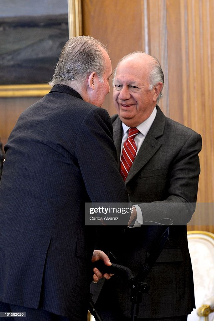 King Juan Carlos of Spain (L) receives former Chilean President <a gi-track='captionPersonalityLinkClicked' href=/galleries/search?phrase=Ricardo+Lagos&family=editorial&specificpeople=218005 ng-click='$event.stopPropagation()'>Ricardo Lagos</a> (R) at Zarzuela Palace on February 12, 2013 in Madrid, Spain.