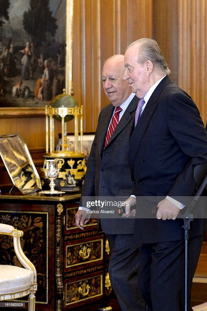 King Juan Carlos of Spain (R) receives former Chilean President <a gi-track='captionPersonalityLinkClicked' href=/galleries/search?phrase=Ricardo+Lagos&family=editorial&specificpeople=218005 ng-click='$event.stopPropagation()'>Ricardo Lagos</a> (L) at Zarzuela Palace on February 12, 2013 in Madrid, Spain.