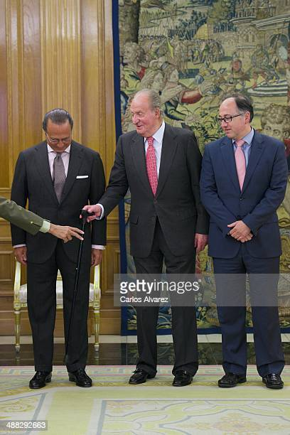 King Juan Carlos of Spain receives IAG President Antonio Vazquez and Iberia President Luis Gallego at the Zarzuela Palace on May 5 2014 in Madrid...