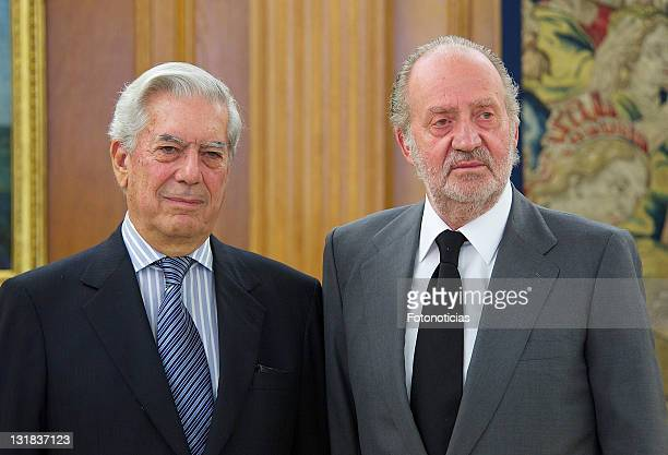 King Juan Carlos of Spain receives writer and Nobel Prize winner Mario Vargas Llosa at Zarzuela Palace on May 11 2011 in Madrid Spain