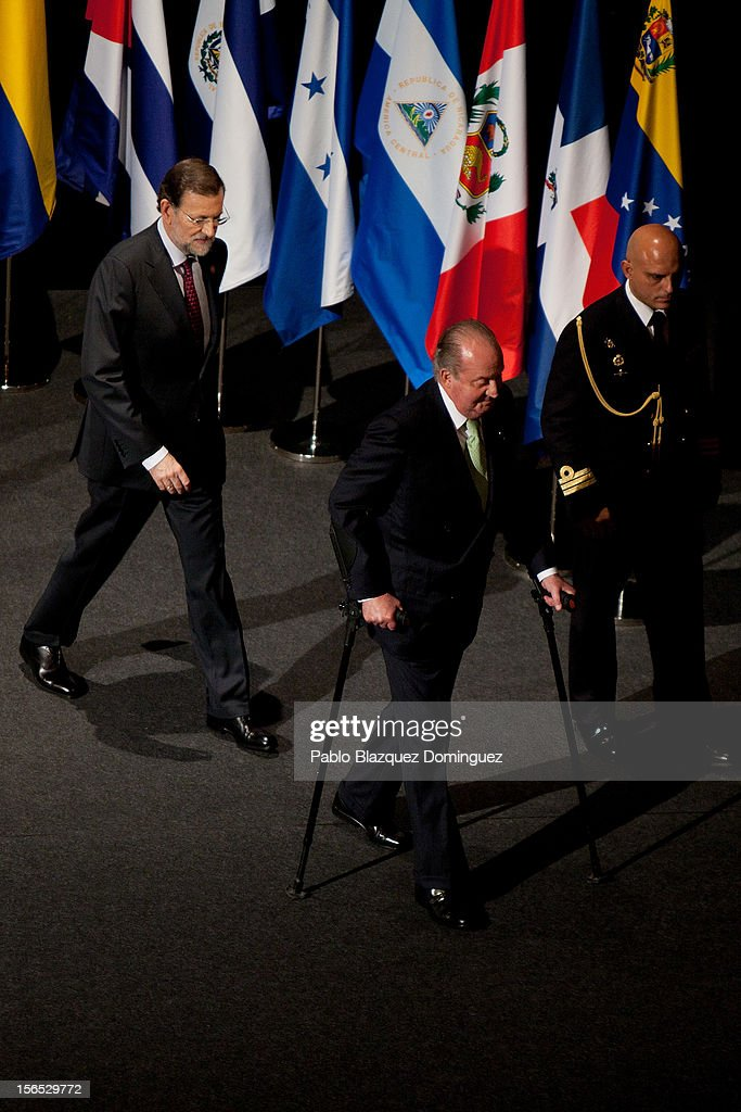 King Juan Carlos of Spain (C) walks out from the stage with his crutches followed by Spain's Prime Minister Mariano Rajoy (L) during the opening ceremony of the XXII Ibero-American Summit at Falla Theatre on November 16, 2012 in Cadiz, Spain. The 22nd Ibero-American Summit is Mariano Rajoy's first as President of Spain and will be attended by 16 Foreign Affairs ministers. The main issues of the meeting will be the economic crisis and how Latin American countries can contribute to the Eurozone recovery.