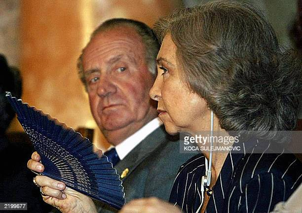 King Juan Carlos of Spain watches his wife Queen Sofia during their visit of Sofia University 10 June 2003 Spanish King Juan Carlos and his wife...