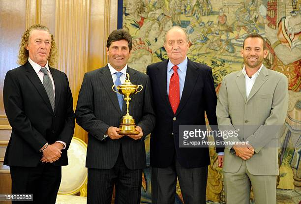 King Juan Carlos receives the Ryder Cup's winners Jose Maria Olazabal Miguel Angel Jimenez and Sergio Garcia on October 16 2012 in Madrid Spain