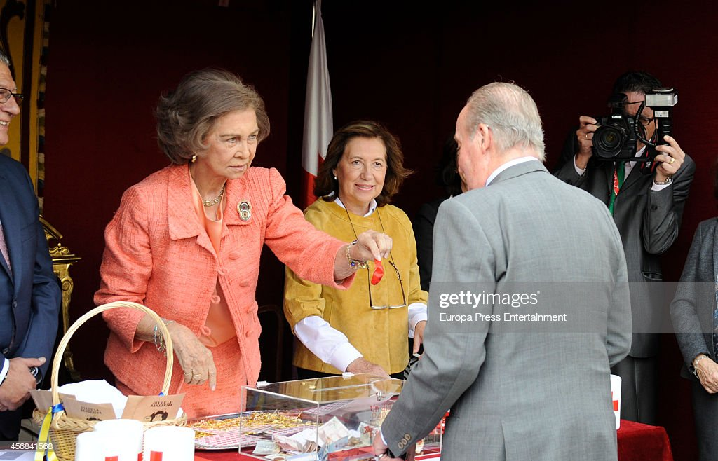 King Juan Carlos visits the charity table presided by Queen Sofia during the Red Cross Fundraising Day event on October 8 2014 in Madrid Spain