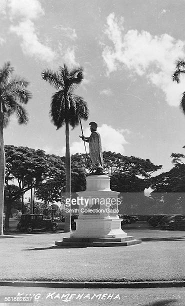 King Kamehameha statue in a peaceful square surrounding by palm trees in Aliiolani Hale Honolulu Hawaii 1950