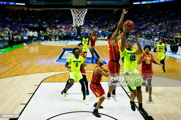 King McClure of the Baylor Bears attempts a layup past De'Anthony Melton of the USC Trojans during the 2017 NCAA Men's Basketball Tournament held at...