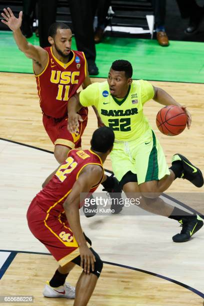King McClure of the Baylor Bears drives past Jordan McLaughlin and De'Anthony Melton of the USC Trojans during the 2017 NCAA Men's Basketball...
