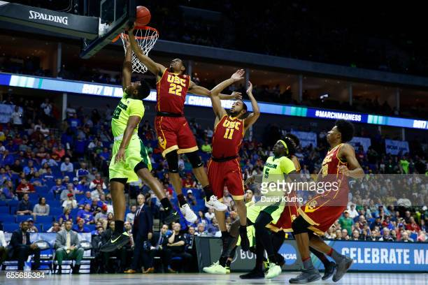 King McClure of the Baylor Bears is blocked by De'Anthony Melton of the USC Trojans during the 2017 NCAA Men's Basketball Tournament held at BOK...