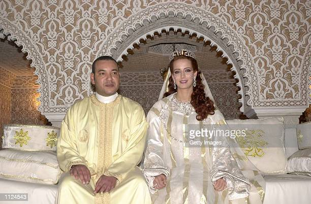 King Mohamed VI of Morocco sits with his wife Princess Lalla Salma at the royal palace July 13 2002 in Rabat Morocco Public celebrations for the...