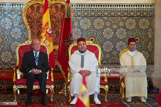 King Mohammed VI of Morocco and his brother Prince Moulay Rachid receive King Juan Carlos of Spain at the Royal Palace during the second day of his...