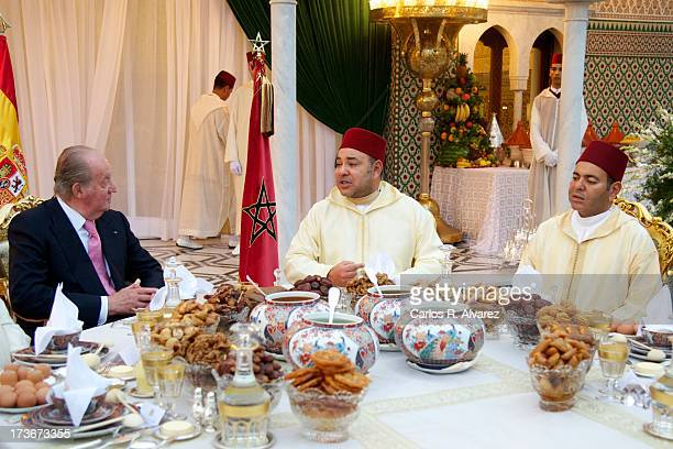 King Mohammed VI of Morocco and his brother Prince Moulay Rachid receive King Juan Carlos of Spain at the Royal Palace for a official dinner during...