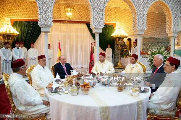 King Mohammed VI of Morocco and his brother Prince Moulay Rachid receives King Juan Carlos of Spain at the Royal Palace for a official dinner during...