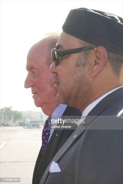 King Mohammed VI of Morocco receives King Juan Carlos of Spain at the Rabat Sale airport on July 15 2013 in Rabat Morocco King Juan Carlos of Spain...