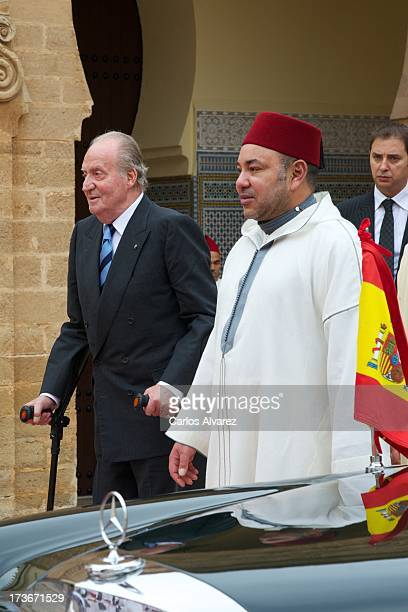 King Mohammed VI of Morocco receives King Juan Carlos of Spain at the Royal Palace for a official dinner during the second day of his visit to...