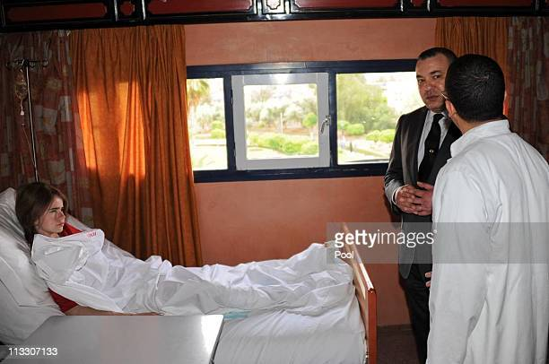 King Mohammed VI visits an injured girl at the Ibn Tofail Hospital on April 30 2011 in Marrakech Morocco A remotecontrolled nail bomb exploded and...