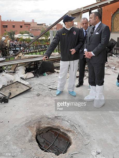 King Mohammed VI visits the site of the bomb blast at Cafe Argana on April 30 2011 in Marrakech Morocco A remotecontrolled nail bomb exploded and...