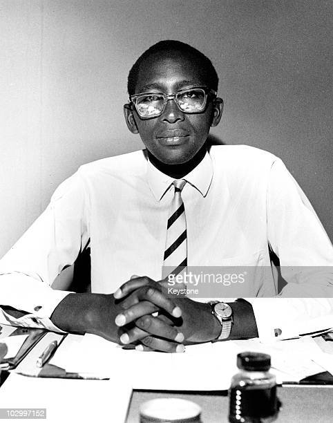 King Moshoeshoe II of Lesotho seated at a desk with paperwork and a bottle of ink in front of him Lesotho South Africa circa 1970