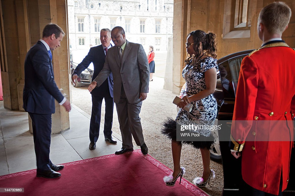<a gi-track='captionPersonalityLinkClicked' href=/galleries/search?phrase=King+Mswati+III&family=editorial&specificpeople=558940 ng-click='$event.stopPropagation()'>King Mswati III</a> of Swaziland and Inkhosikati LaMbikiza arrive at a lunch For Sovereign Monarchs in honour of Queen Elizabeth II's Diamond Jubilee, at Windsor Castle, on May 18, 2012 in Windsor, England.