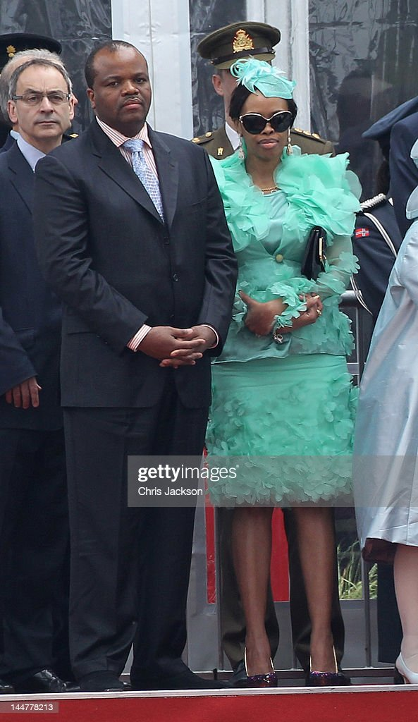 <a gi-track='captionPersonalityLinkClicked' href=/galleries/search?phrase=King+Mswati+III&family=editorial&specificpeople=558940 ng-click='$event.stopPropagation()'>King Mswati III</a> of Swaziland and Inkhosikati LaMbikiza of Swaziland attend the Armed Forces Parade and Muster in Home Park on May 19, 2012 in Windsor, England. Over 2500 troops took part in the Diamond Jubilee Muster in Home Park.