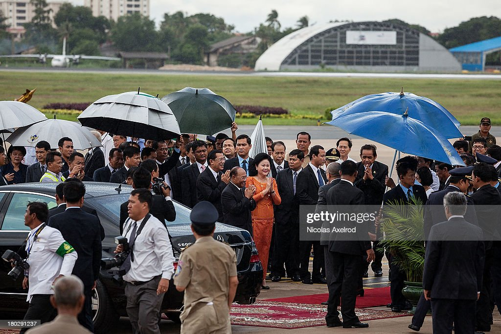 King Norodom Sihamoni and Queen Mother Norodom Monineath arrives at the Phnom Penh airport, they were welcomed by PM <a gi-track='captionPersonalityLinkClicked' href=/galleries/search?phrase=Hun+Sen&family=editorial&specificpeople=224084 ng-click='$event.stopPropagation()'>Hun Sen</a> and opposition leader Sam Rainsy on September 11, 2013 in Phnom Penh, Cambodia. King Norodom Sihamoni returns to Cambodia amid election controversy and has been asked by the opposition leader to intervene in the election dispute. The King had been in China where it is said he was receiving a medical check up.