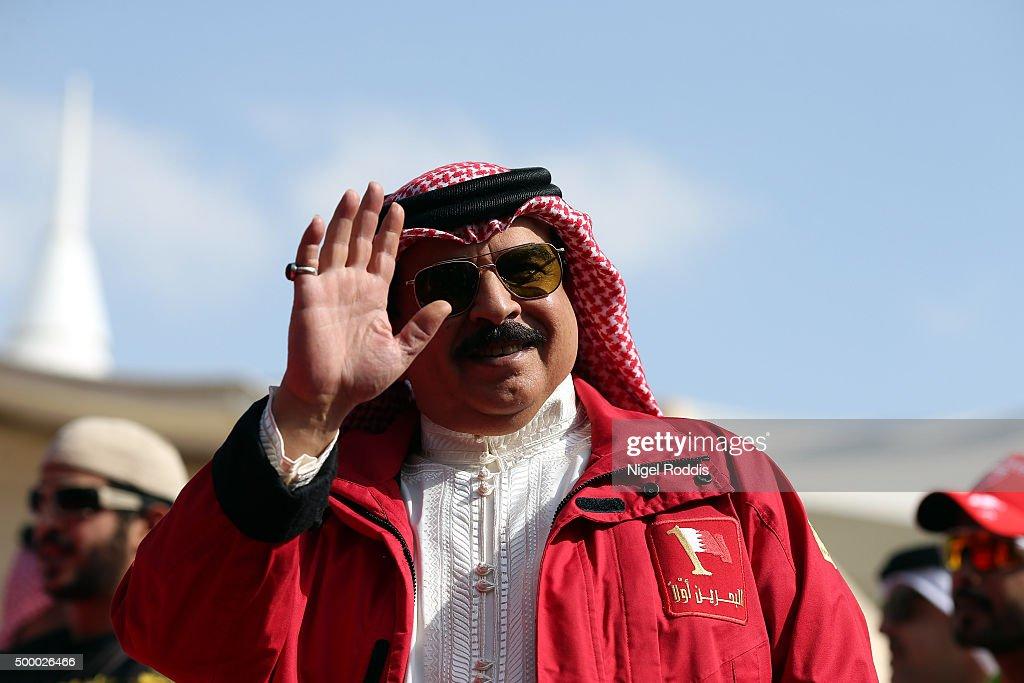 King of Bahrain Hamad bin Isa Al Khalifa waves to the crowd on the finishing line of Ironman Bahrain on December 5, 2015 in Bahrain, Bahrain.