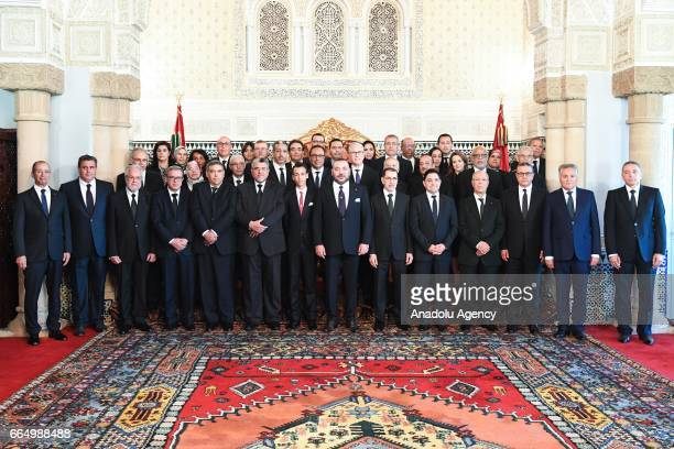 King of Morocco Mohammed VI and Head of the National Council of Justice and Development Party Saadeddine Othmani pose for a family photo with the...