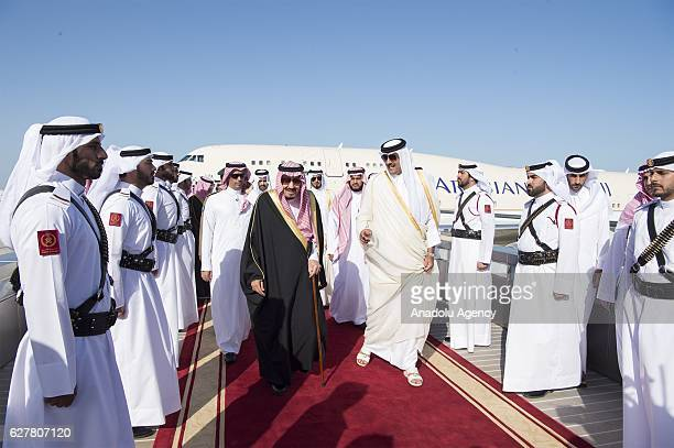 King of Saudi Arabia Salman bin Abdulaziz is welcomed by Emir of Qatar Sheikh Tamim bin Hamad Al Thani at Hamad International Airport in Doha Qatar...