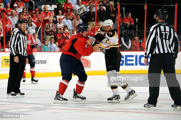 J King of the Washington Capitals fights with Shawn Thornton of the Boston Bruins at Verizon Center on September 28 2010 in Washington DC