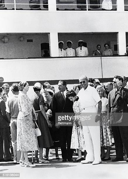 King Paul of Greece is shown with some of his royal guests on the dock just before the SS Agamemnon left Naples on the 'Cruise of Kings' Guests were...