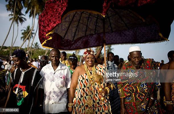 King Peggielene 'Peggy' Bartels walks with town elders during the celebration of the Harvest Festival in Otuam Ghana on Ocotber 3 2009 After being...