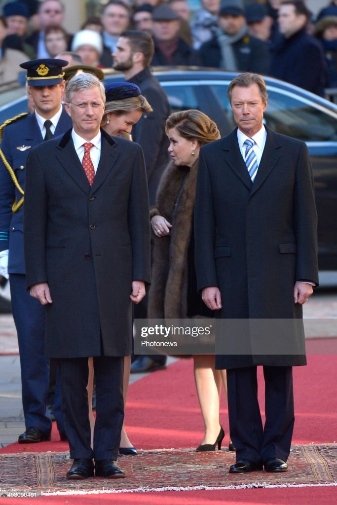 King Philippe (L) and Queen Mathilde (back L) of Belgium attend a welcome ceremony hosted by Henri, Grand Duke of Luxembourg (R) and Maria Teresa, Grand Duchess of Luxembourg (2nd R) at Grand Ducal Palace on December 2, 2013 in Luxembourg City, Luxembourg. King Philippe and <a gi-track='captionPersonalityLinkClicked' href=/galleries/search?phrase=Queen+Mathilde+of+Belgium&family=editorial&specificpeople=239189 ng-click='$event.stopPropagation()'>Queen Mathilde of Belgium</a>, accompanied by Belgian Prime Minister Elio Di Rupo and Belgian Foreign Minister Didier Renders, are on a one-day official state visit to Luxembourg.