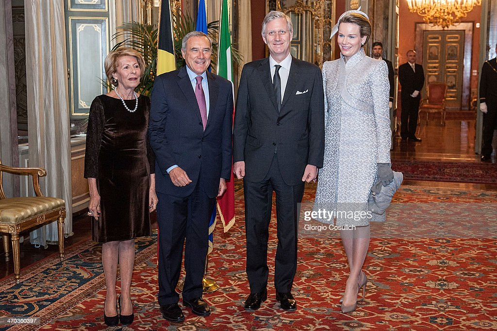 King Philippe (C) and Queen Mathilde of Belgium greet Italian President of Senate Pietro Grasso (L) and his wife Maria Fedele as they arrive at Palazzo Giustiniani on February 19, 2014 in Rome, Italy.