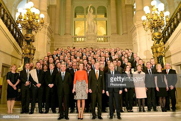 King Philippe and Queen Mathilde of Belgium pose for a group photograph during a reception for heads of Belgian diplomatic missions abroad as part of...