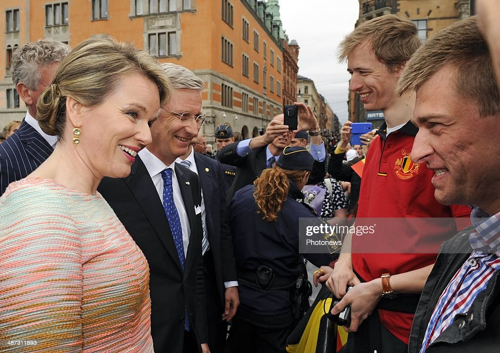King Philippe and <a gi-track='captionPersonalityLinkClicked' href=/galleries/search?phrase=Queen+Mathilde+of+Belgium&family=editorial&specificpeople=239189 ng-click='$event.stopPropagation()'>Queen Mathilde of Belgium</a> take a short walk to Rosenbad and greet members of the public during their visit to Sweden on April 29, 2014 in Stockholm, Sweden.