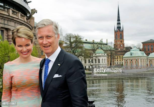 King Philippe and Queen Mathilde of Belgium take a short walk to Rosenbad during their visit to Sweden on April 29 2014 in Stockholm Sweden