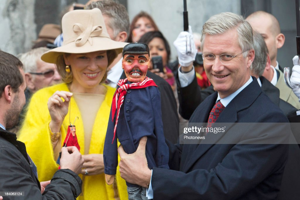 King Philippe and <a gi-track='captionPersonalityLinkClicked' href=/galleries/search?phrase=Queen+Mathilde+of+Belgium&family=editorial&specificpeople=239189 ng-click='$event.stopPropagation()'>Queen Mathilde of Belgium</a> visit the city of Liege as part of the royal couple's tour of the provinces on October 11, 2013 in Belgium.