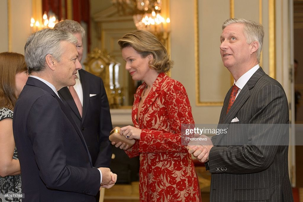 King Philippe and Queen Mathilde pictured during the New Year reception held for the members of the SHAPE and NATO based in Belgium on January 16, 2014 in Brussels, Belgium. King Philippe and Queen Mathilde pictured discussing with Minister Reynders and De Crem.