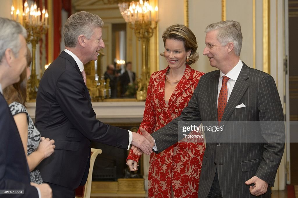 King Philippe and Queen Mathilde pictured during the New Year reception held for the members of the SHAPE and NATO based in Belgium on January 16, 2014 in Brussels, Belgium. King Philippe shaking hands with Minister De Crem.