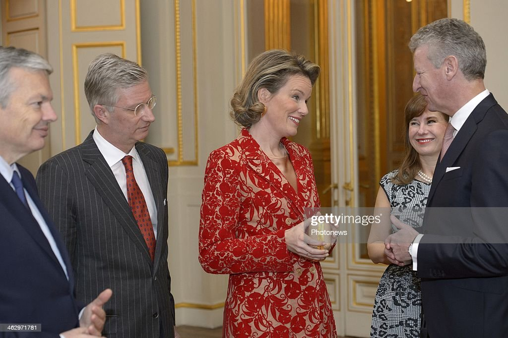 King Philippe and Queen Mathilde pictured during the New Year reception held for the members of the SHAPE and NATO based in Belgium on January 16, 2014 in Brussels, Belgium. King Philippe and Queen Mathilde pcitured while having a chat with Minister Pieter De Crem and Didier Reynders.