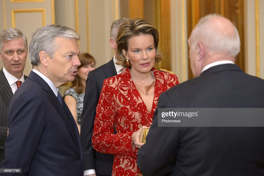 King Philippe and Queen Mathilde pictured during the New Year reception held for the members of the SHAPE and NATO based in Belgium on January 16, 2014 in Brussels, Belgium. Queen Mathilde pictured having a chat with Minister Didier Reynders.