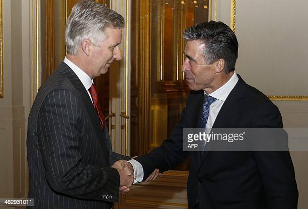 King Philippe Belgium and NATO Secretary General Anders Fogh Rasmussen shake hands during a reception by the Royal family for representatives of...