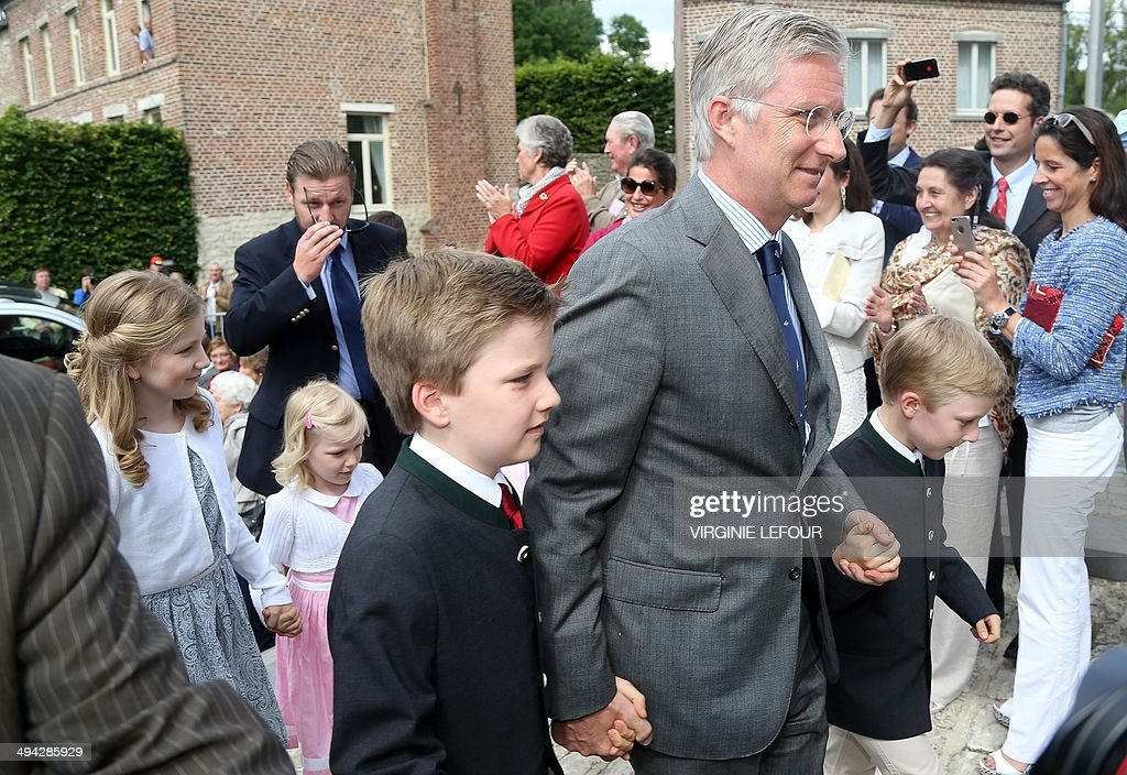 King Philippe - Filip of Belgium (2nd R) accompanies twin princes Nicolas and Aymeric as they arrive for their first communion, followed by Princess Elisabeth (L) and Princess Eleonore (2nd L), at the Sainte-Catherine church in Bonlez on May 29, 2014. AFP PHOTO / BELGA / VIRGINIE LEFOUR **Belgium Out**