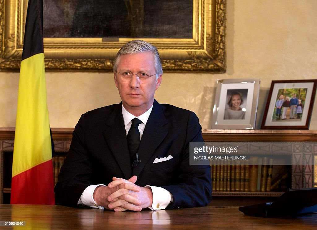 TOPSHOT King Philippe Filip of Belgium addresses a speech on March 22 2016 in Brussels after a series of explosions claimed by the Islamic State...