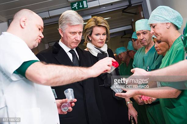 TOPSHOT King Philippe Filip of Belgium and Queen Mathilde of Belgium look at fragments of iron shrapnel from a nail bomb found in victim's bodies as...